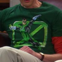 Sheldon wearing Green Lantern Flying X shirt