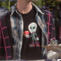 Stuart wearing Lil Alien shirt